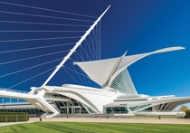 Milwaukee Art Museum - Milwaukee WI - The Quadracci Pavilion created by Spanish architect Santiago Calatrava in  contains a movable wing-like brise soleil that opens for a wingspan of  feet  m during the day folding over the tall arched structure at night