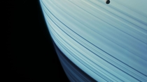 Mimas floats above the skies of Saturn Cassini