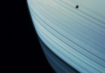 Mimas Transits Saturns Ring Shadows