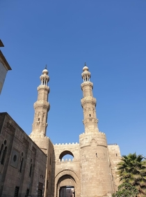 Minarets of the Mosque of Sultan al-Muayyad on top of the Fatimid-era gate Bab Zuweila  Cairo Egypt