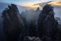 Mind blowing frost covered peaks at sunrise in Huangshan  bloveimages
