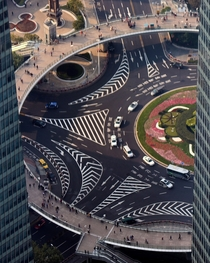 Mingzhu roundabout in Shanghai China with neat lane markings and an elevated pedestrian walkway