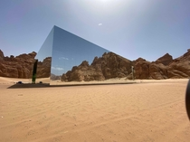 Mirrored concert hall in the middle of the desert