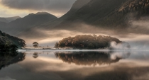 Mist and Reflections Crummock Water Cumbria by Tony Bennett