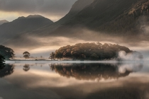 Mist and Reflections over Crummock Water of Cumbria England  Tony Bennett