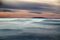 Mist covers the hills in Harzvorland Germany