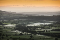 Mist lies in a valley near Goathland in the North Yorkshire Moors at sunrise