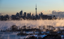 Mist rises from Lake Ontario in front of the Toronto skyline Mark Blinch