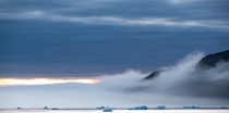 Misty cloudys crashing up against mountains in Thule Region of Avannataa near Siorapaluk Greenland