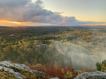 Misty mountain top sunrise Huron Mountains Michigan