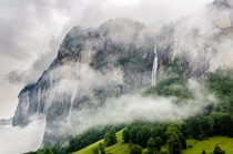 Misty waterfalls in the Lauterbrunnen Valley Switzerland