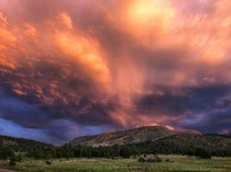 Monsoon sunset rain clouds over Escudilla Mountain in White Mountains Arizona