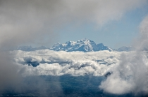 Mont Blanc from  km away finally appearing through a break in the clouds