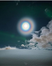 Moon corona in the midst of auroras