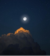 Moon illuminates clouds photo by Astrovas