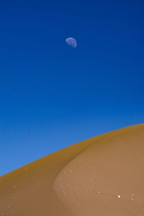 Moon over dune San Pedro de Atacama Chile