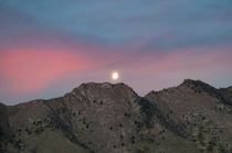 Moon set over a sunrise - Death Valley CA