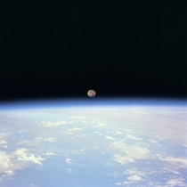 Moon Set over Earth taken from Space Shuttle Discovery during STS-