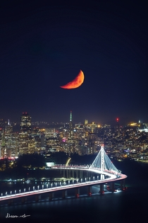 Moon setting over San Francisco with a long telephoto