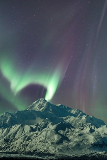 Moonlit Northern lights over Denali in Alaska