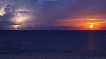 Moonrise alongside a lightning strike photo credit Kaan Pala in Jupiter Florida