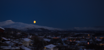 Moonrise over snowcovered mountains - Bod Norway