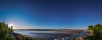 Moonset and sunrise over the Waimakariri River Canterbury New Zealand