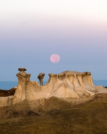 Moonset over the Bisti Badlands of New Mexico One of the strangest landscapes Ive ever seen