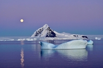 MoonsetSunrise below the Polar Circle in Antarctica