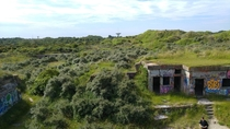 More overgrown bunkers just past the sand of the beaches of Normandy