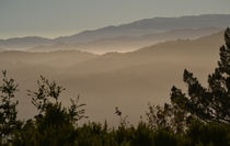 Morning Fog over layers of mountains in Carmel Valley CA Taken during a trail-building job of mine See more at seanaimages