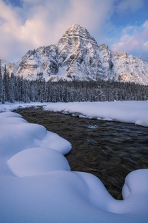 Morning light on a prominent mountain along the Icefields Parkway in Canada