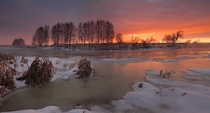 Morning light on the partially frozen Miass River Russia