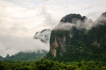 Morning mist on the mountains in Vang Vieng Laos  x