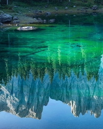 Morning reflections in Lago di Carezza Italy