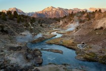Morning steam rises from Hot Creek near Mammoth Lakes CA