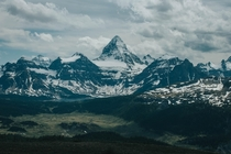 Mount Assiniboine - Known as the Matterhorn of the Rockies is one of the most prominent peaks I have ever seen I was lucky enough to catch an incredible view on a clear day in July Often times the peak is surrounded by clouds  - Photographer Ian Feil ianf