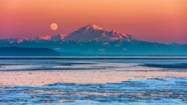 Mount Baker Full Moon at sunset on a cold winter evening from the shores of Boundary Bay BC Canada by Pierre Leclerc
