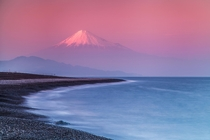 Mount Fuji in a pink haze at sunset I love the minimal style of this photo  photo by Jormungand