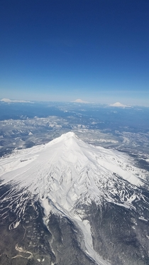 Mount Hood from the sky with St Helens Rainier and Adams in the background