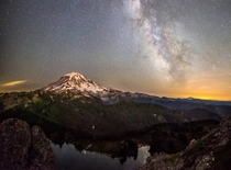 Mount Rainier and the Milky Way reflected in the water  Photographed by Craig Goodwin