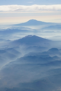 Mount St Helens and Mount Adams in last summers forest fire smoke over Washington