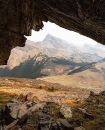 Mountain framed by a mountain shaped cave Alberta Canada  ignatureprofessor