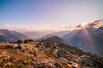 Mountain haze and pink sun rays Near Fiesch Switzerland  by hansiphoto