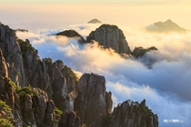 Mountain Huangshan of Anhui China at sunrise Mt Huangshan is famous for its sunrise and sea of clouds