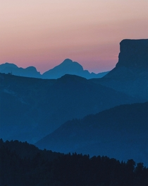 Mountain layers and pink skies before sunrise in the Dolomites