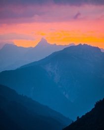 Mountain layers beneath a rosey sky Zrs Switzerland  by hansiphoto