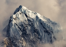 Mountain peak emerging from the clouds near Gokyo Lake NepalOC
