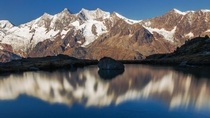 Mountain reflections above Saas-fee Valais Switzerland
