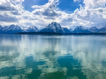 Mountains in Grand Teton National Park reflecting off of a lake  x